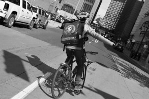 Black and white of bike courier rear